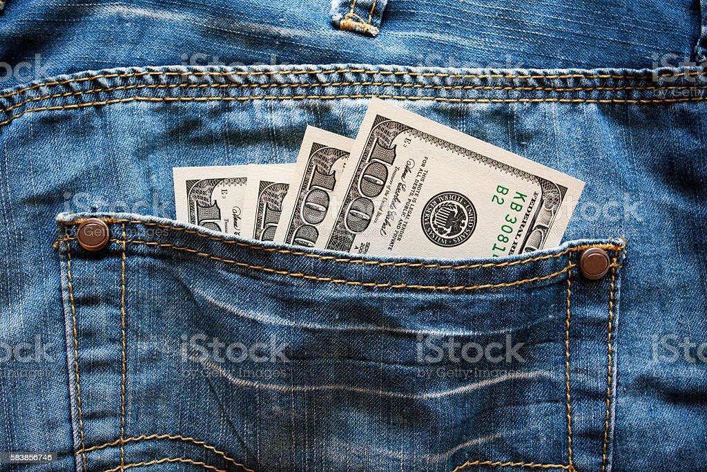U.S. dollars in the back jeans pocket stock photo