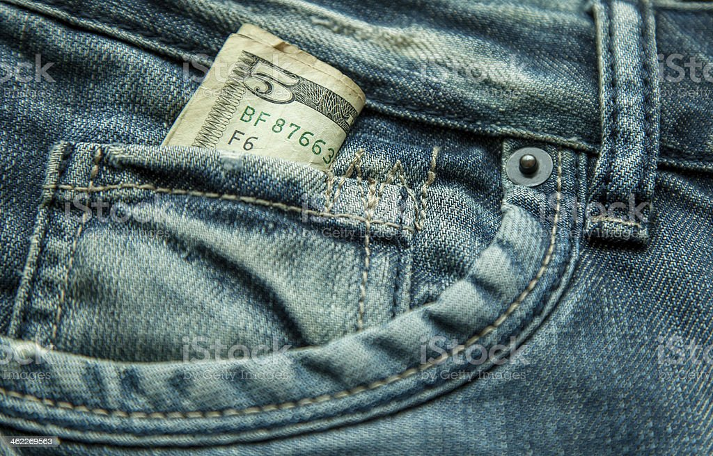 5 dollars  in the pocket of jeans stock photo