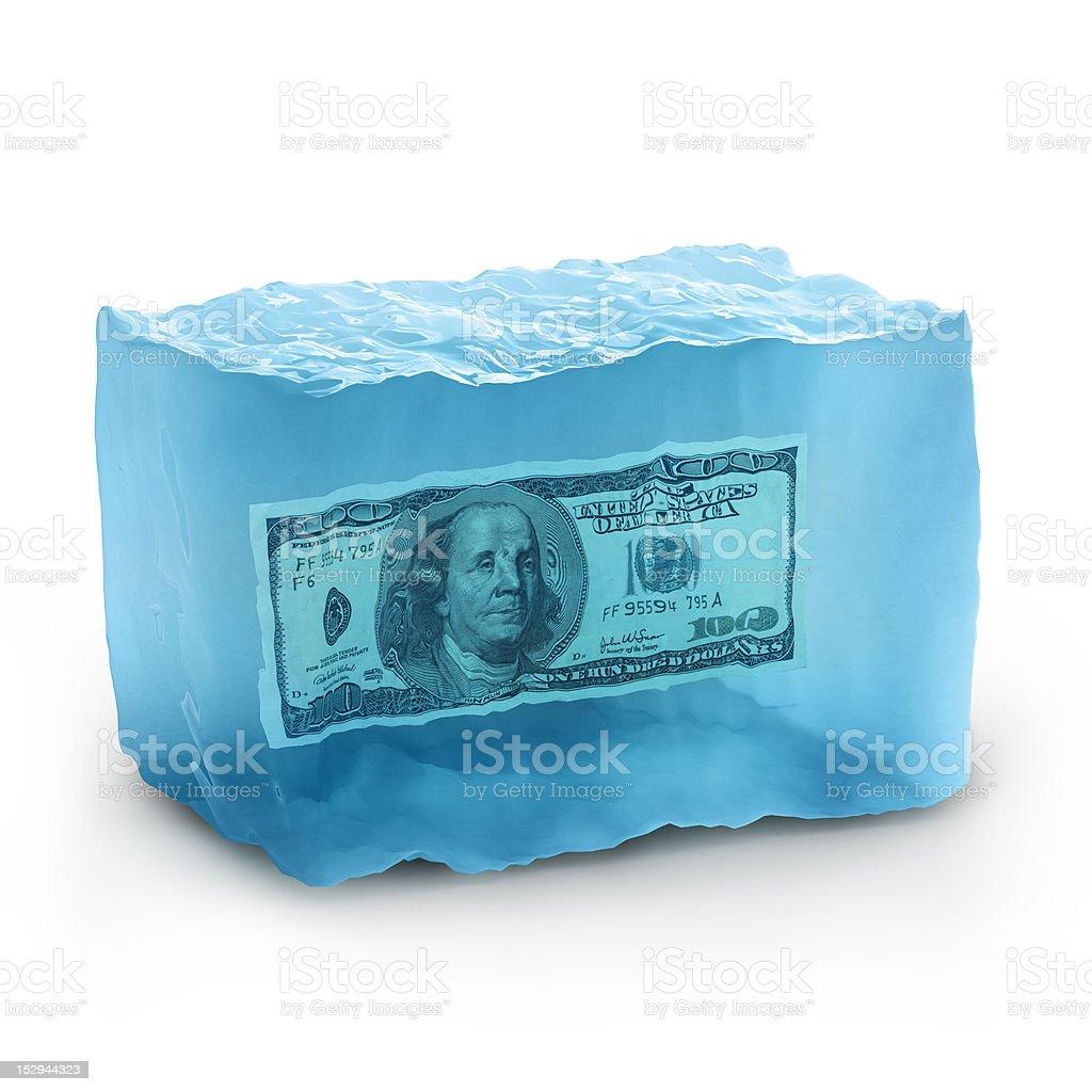 dollars on ice stock photo