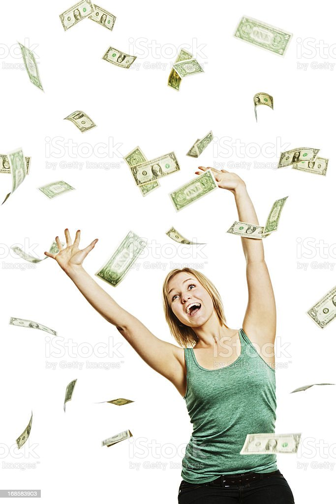Dollars rain down onto a delighted laughing young blonde stock photo