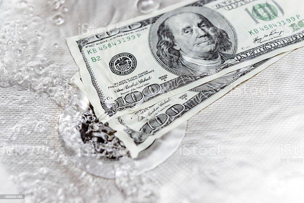 dollars sinking stock photo