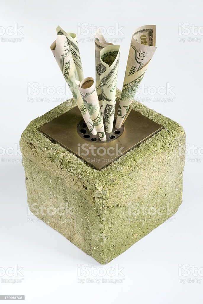 Dollars stuck in an isolated drain royalty-free stock photo