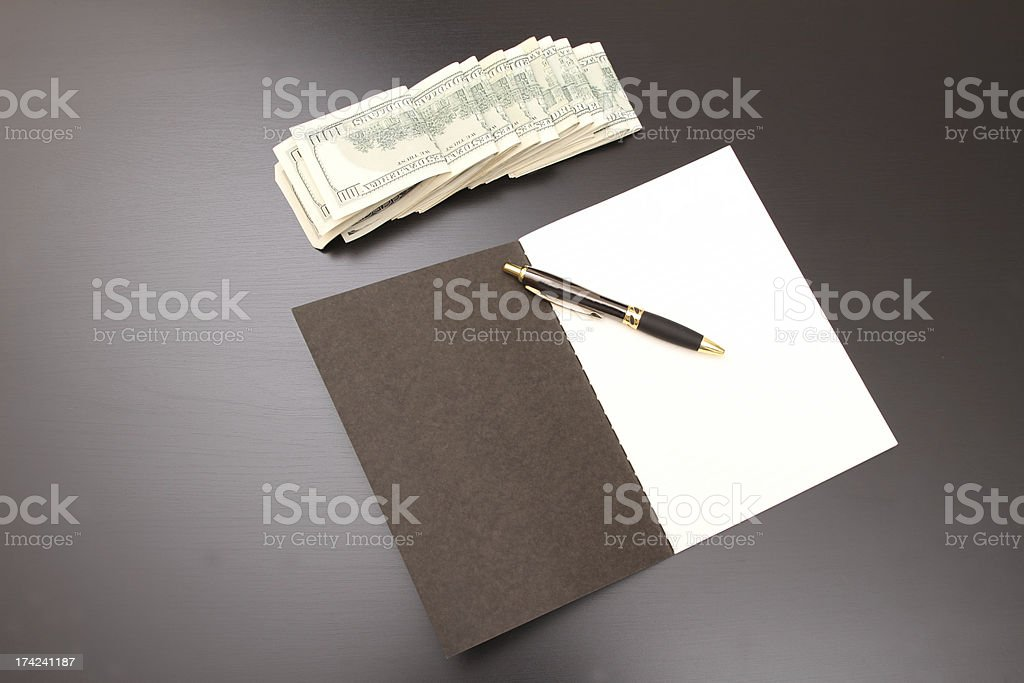 Dollars with a copybook royalty-free stock photo