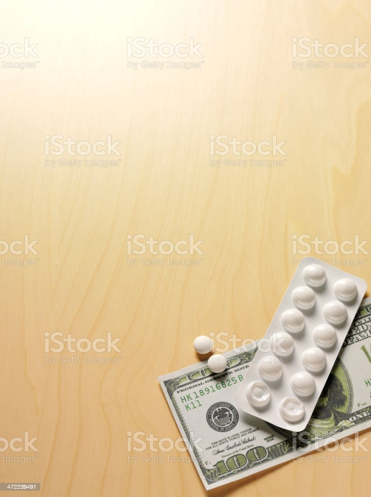 100 Dollars with Prescription Tablets stock photo