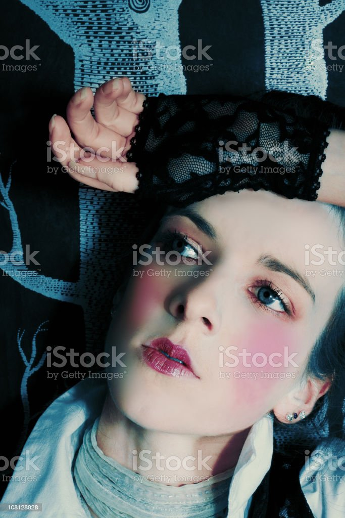 Doll-Like Young Woman with Pink Cheeks stock photo