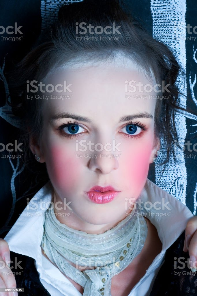 Doll-Like Young Woman with Pink Cheeks royalty-free stock photo
