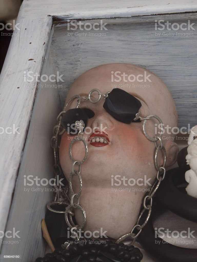 Doll's head in a glass case stock photo
