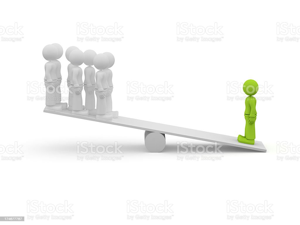 Dolls standing on both sides of a seesaw stock photo