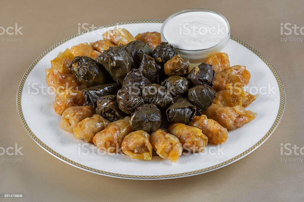 Dolma in grape leaves & cabbage rolls stock photo