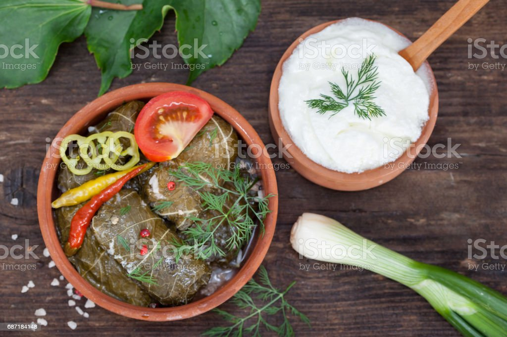 Dolma with yogurt sauce stock photo
