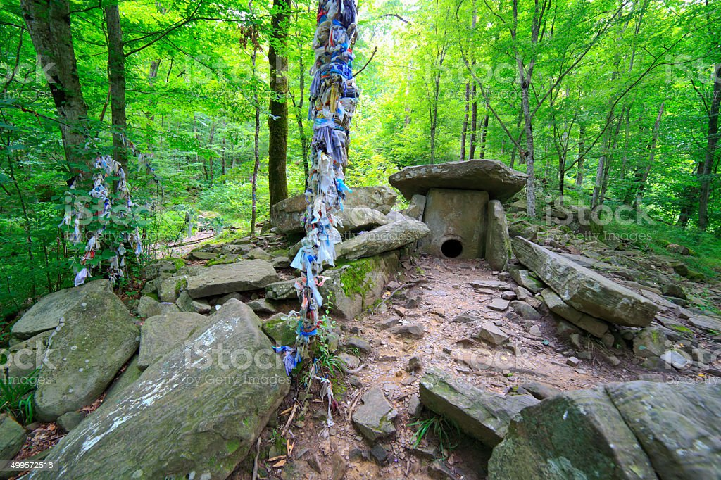 Dolmen at the forest ancient prehistoric building stock photo