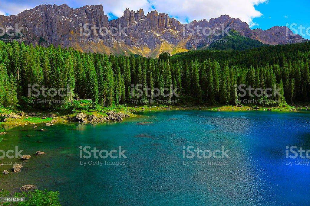Dolomites alpine Carezza turquoise lake - Karersee, Latemar, Tirol stock photo