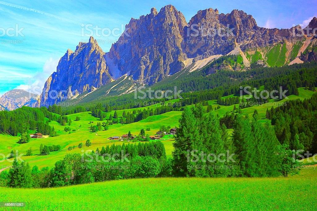 Dolomites alpine village, Green meadow, Cortina at sunrise, South Tirol stock photo