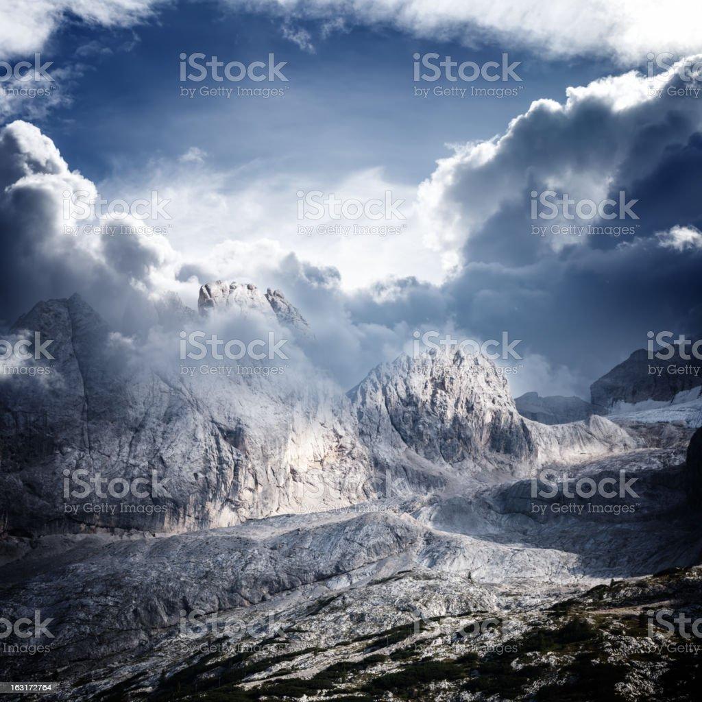 Dolomites mountain ridge in clouds stock photo
