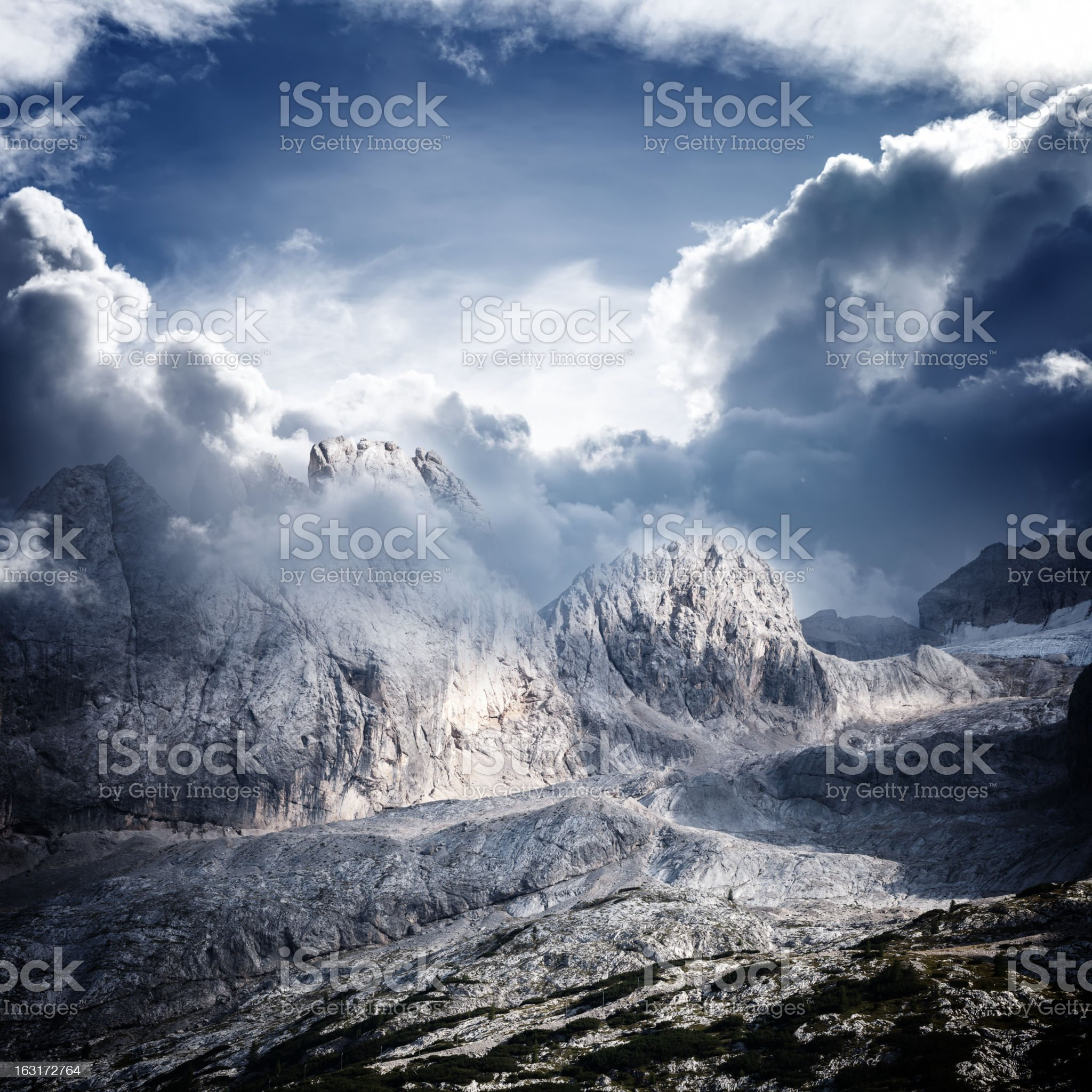 Dolomites mountain ridge in clouds royalty-free stock photo