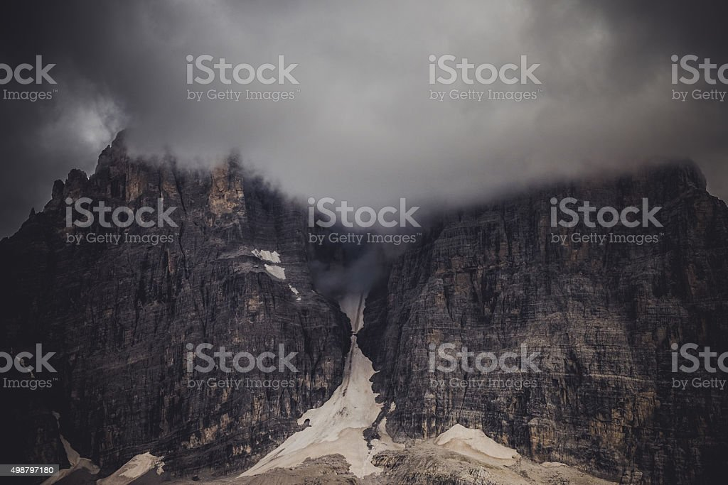 Dolomites of Brenta into the Clouds, Italy stock photo