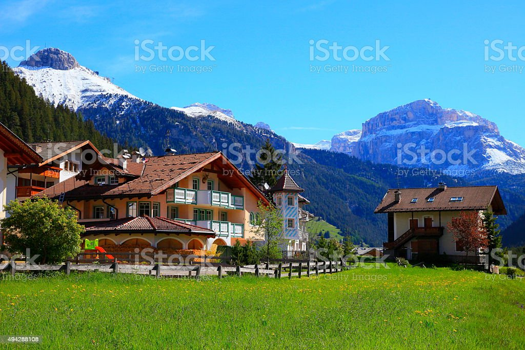 Dolomites paradise: Italian alpine village, swiss chalets, green valley stock photo