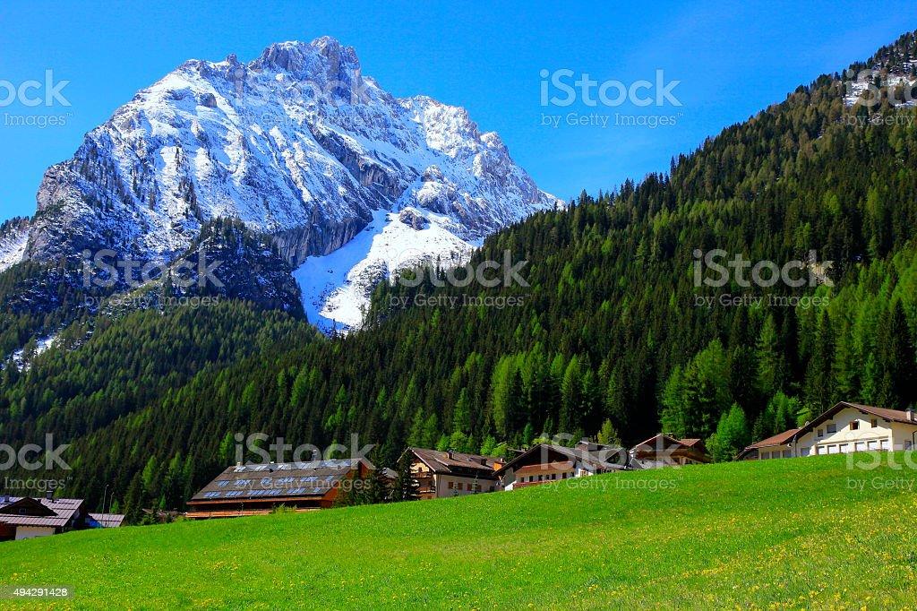 Dolomites paradise: Italian alpine village, swiss chalets, green valley stock photo