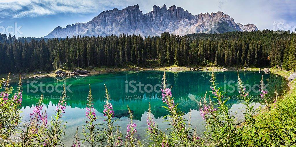 Dolomites: the beautiful colors of the lake Carezza stock photo