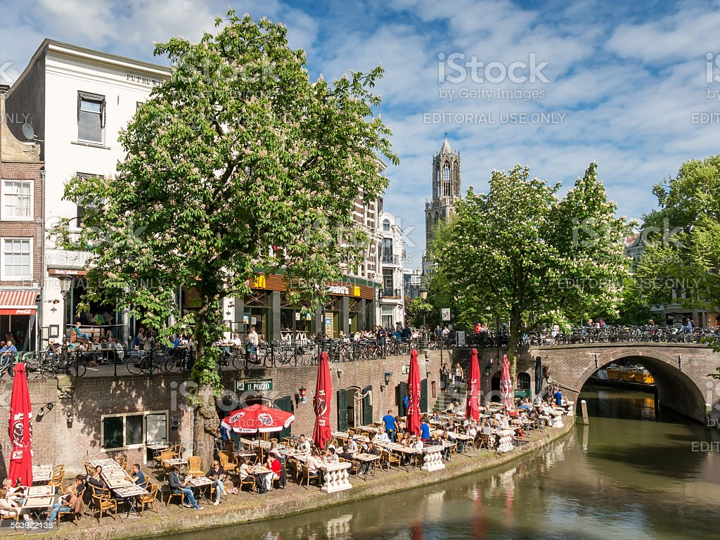 Dom Tower and Oudegracht canal in Utrecht, Netherlands stock photo