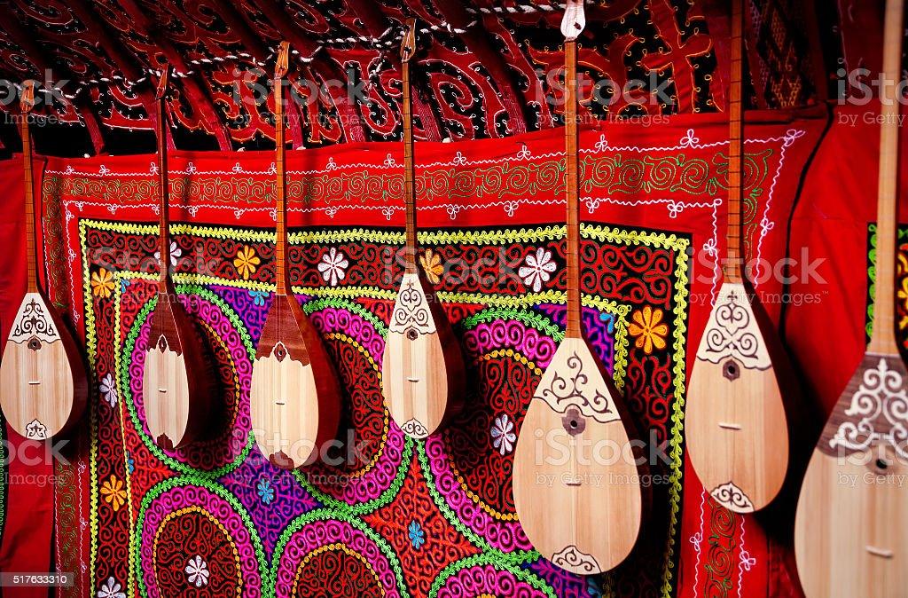 Dombra instrument in Kazakh yurt interior stock photo