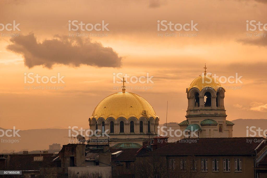 dome of a church at sunrise stock photo