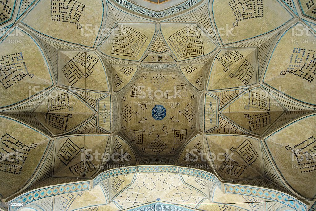 Dome of an ancient mosque, oriental ornaments from Isfahan, Iran royalty-free stock photo