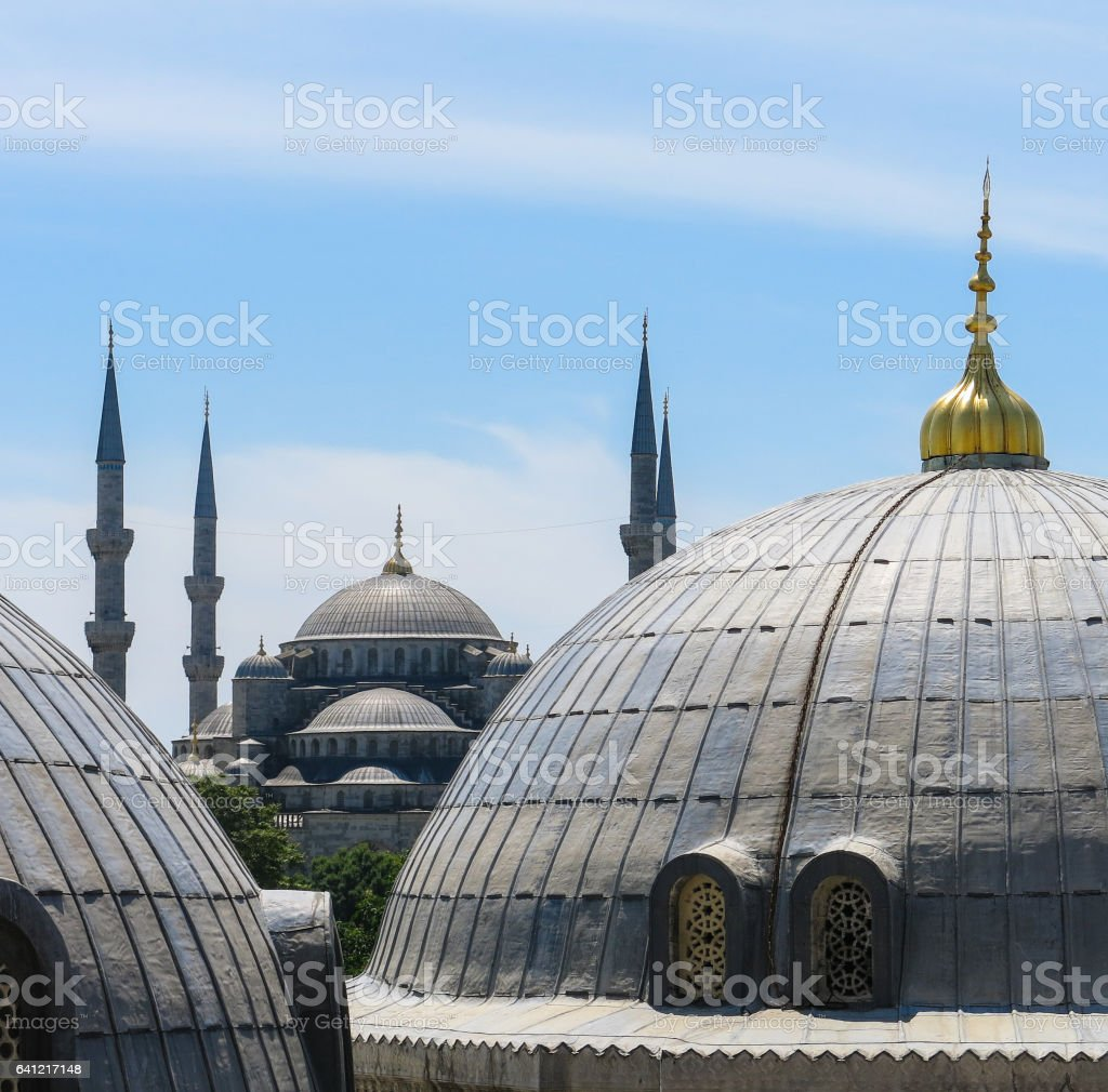 Domes of Saint Sophie Cathedral and Blue Mosque, from Saint Sophie, Istanbul, Turkey. stock photo