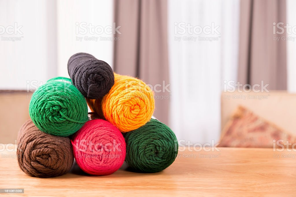 Domestic Life:  Knitting left on dining table.  Back to basics.. royalty-free stock photo