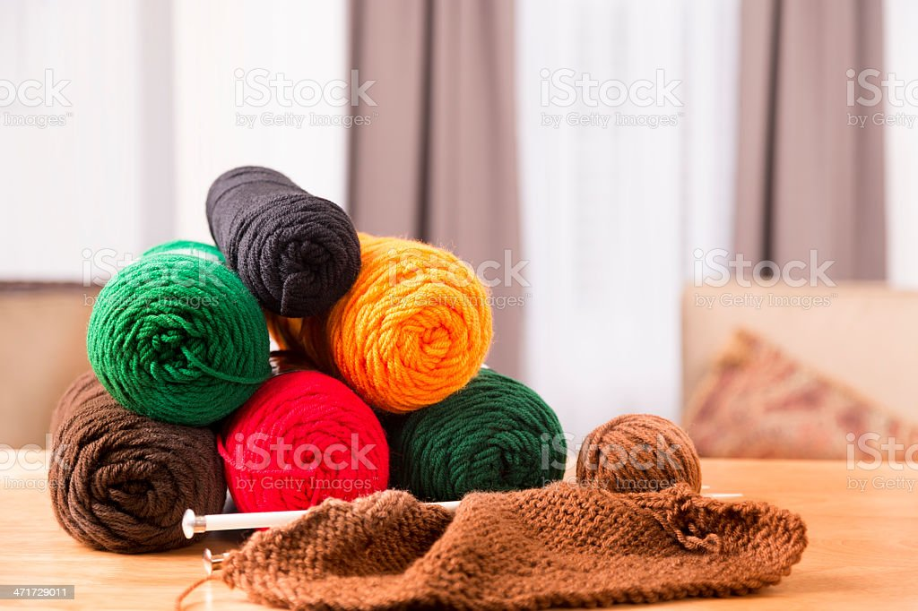 Domestic Life:  Knitting left on dining table.  Back to basics. royalty-free stock photo