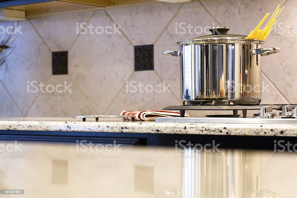 Domestic Life:  Pasta cooks in pot on stove. royalty-free stock photo