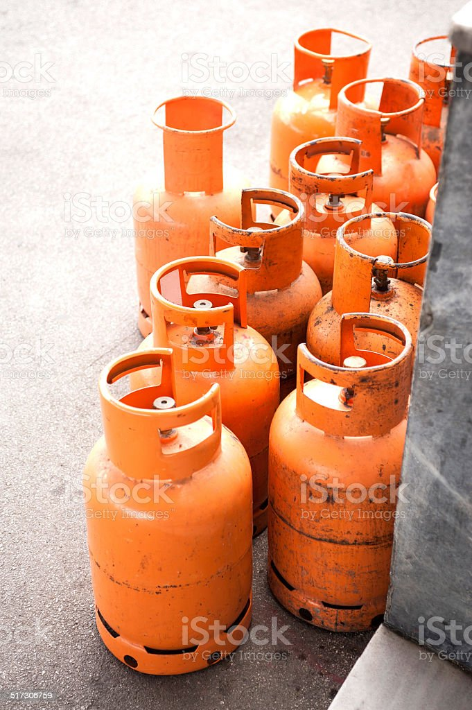 Domestic propane gas bottles ready to be refilled and recycled stock photo
