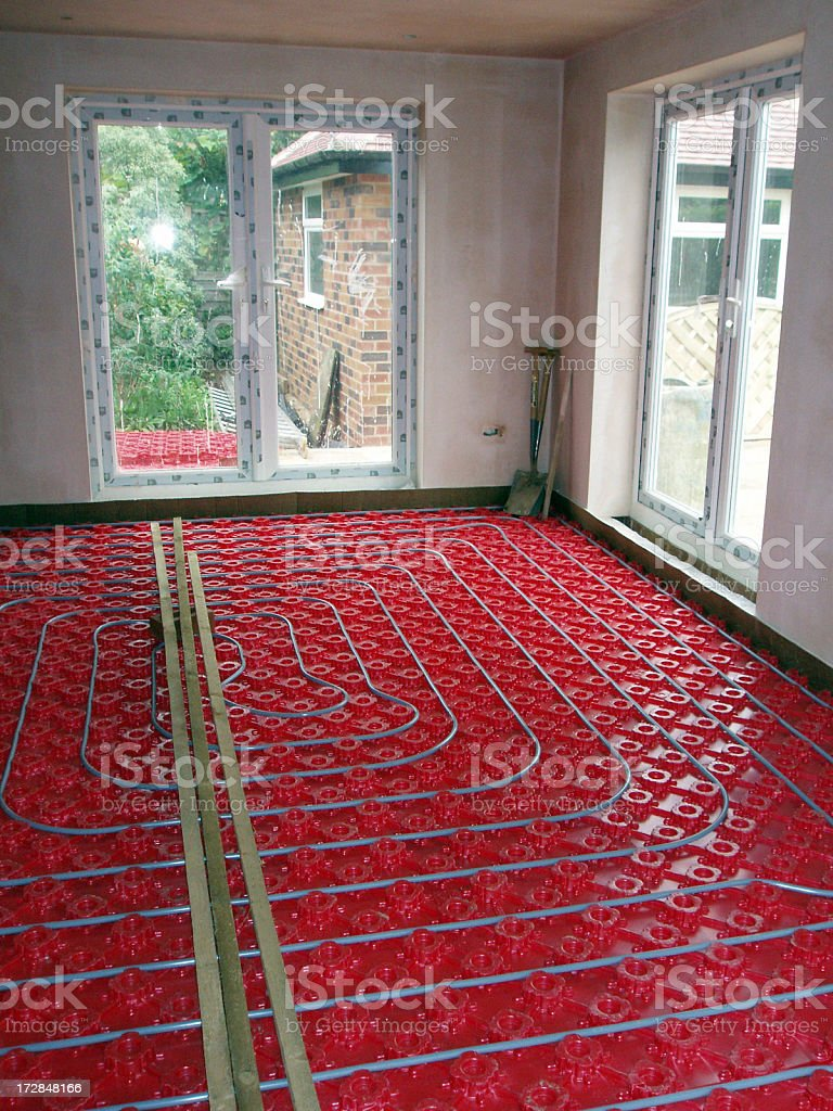 domestic underfloor heating construction of hot water pipes stock photo
