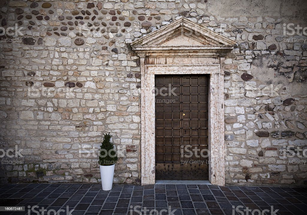dominant medieval entrance and stone wall stock photo