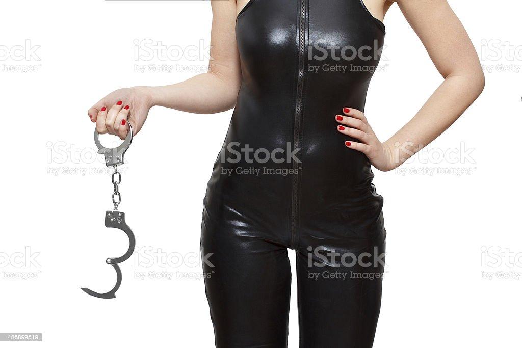 Dominatrix holding handcuffs closeup royalty-free stock photo