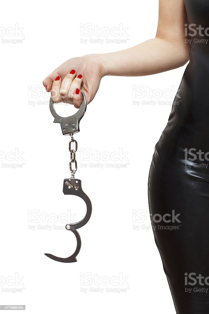 Dominatrix holding handcuffs royalty-free stock photo