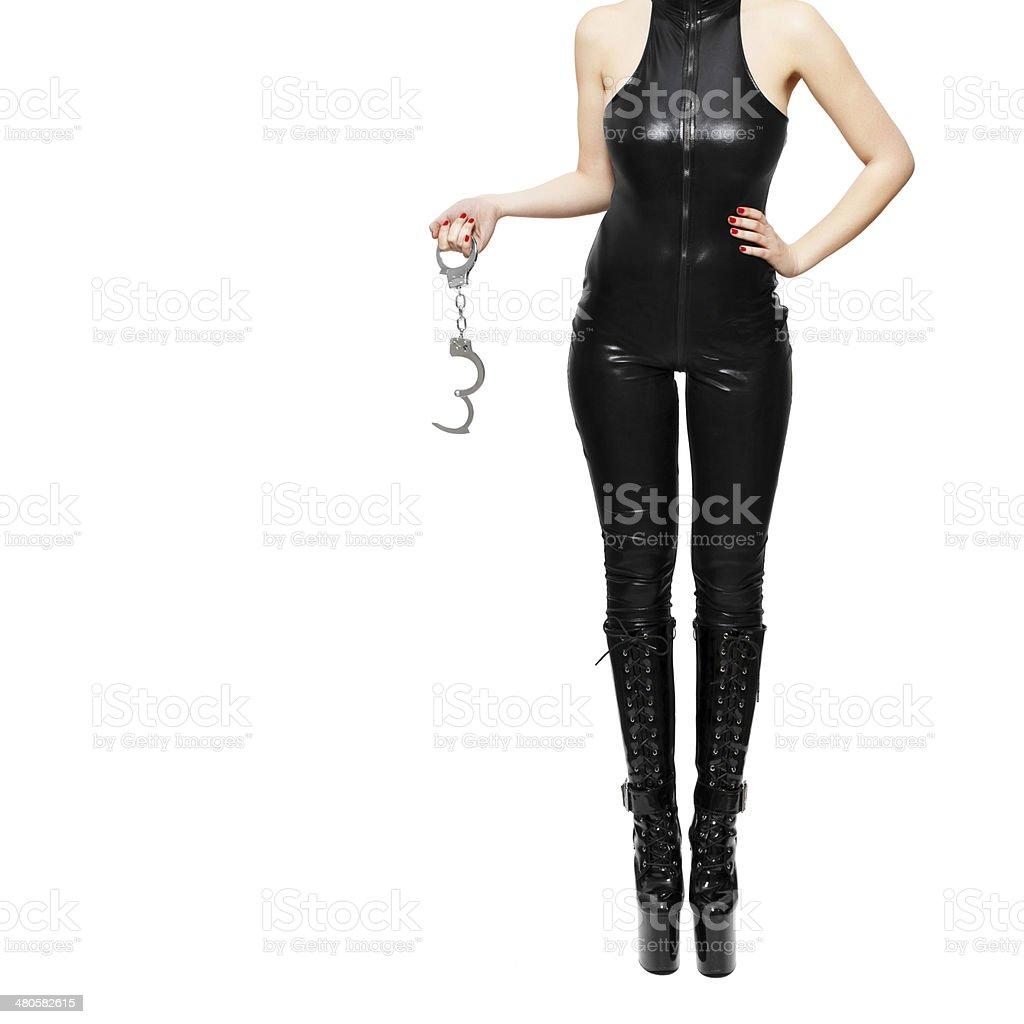 Dominatrix holding handcuffs royalty-free stock photo