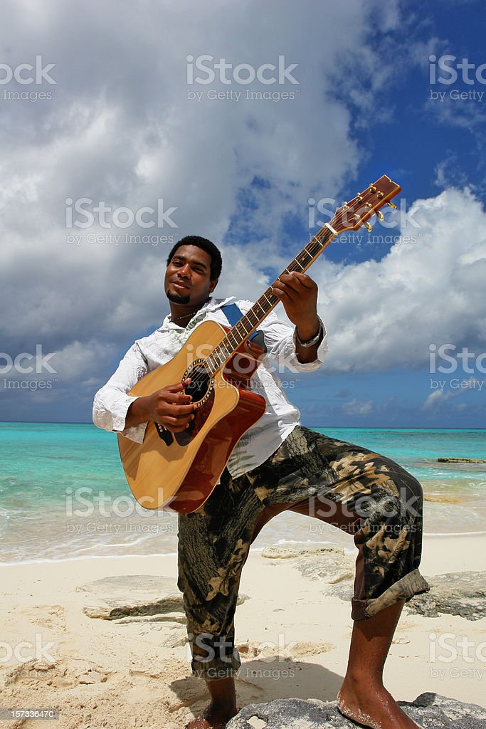 Dominican boy playing his guitar royalty-free stock photo
