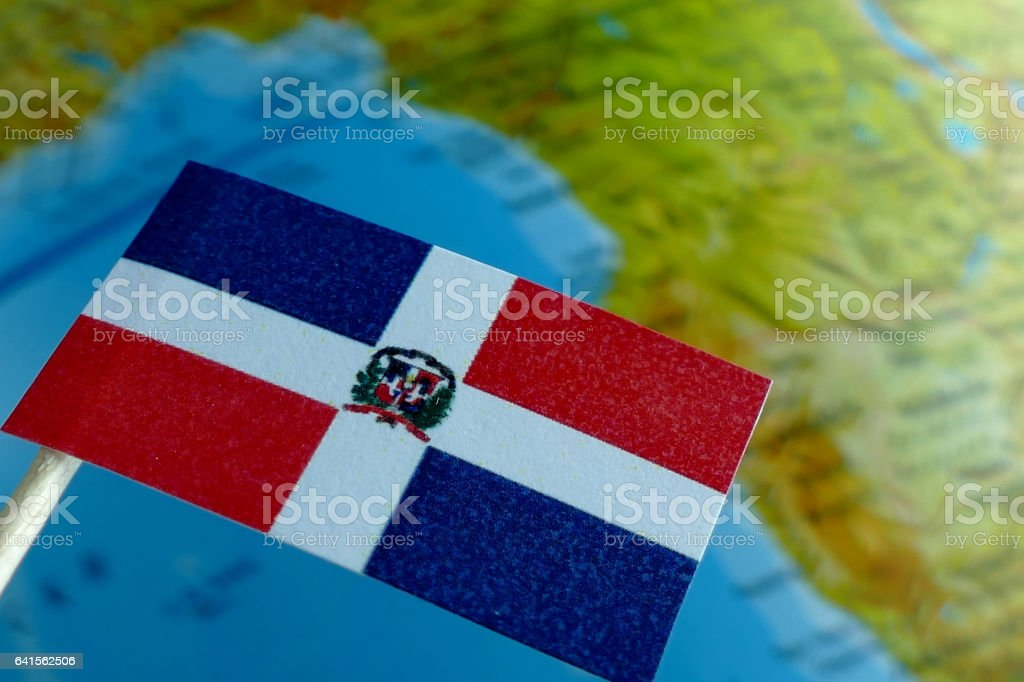 Dominican Republic flag with a globe map as a background stock photo