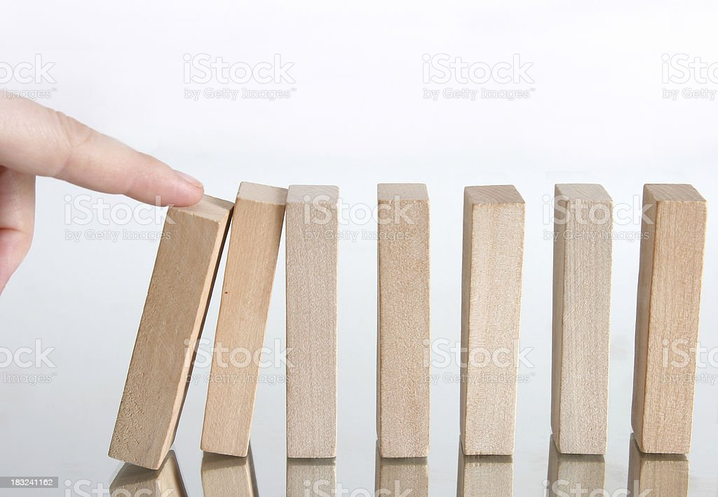 domino effect, going down stock photo