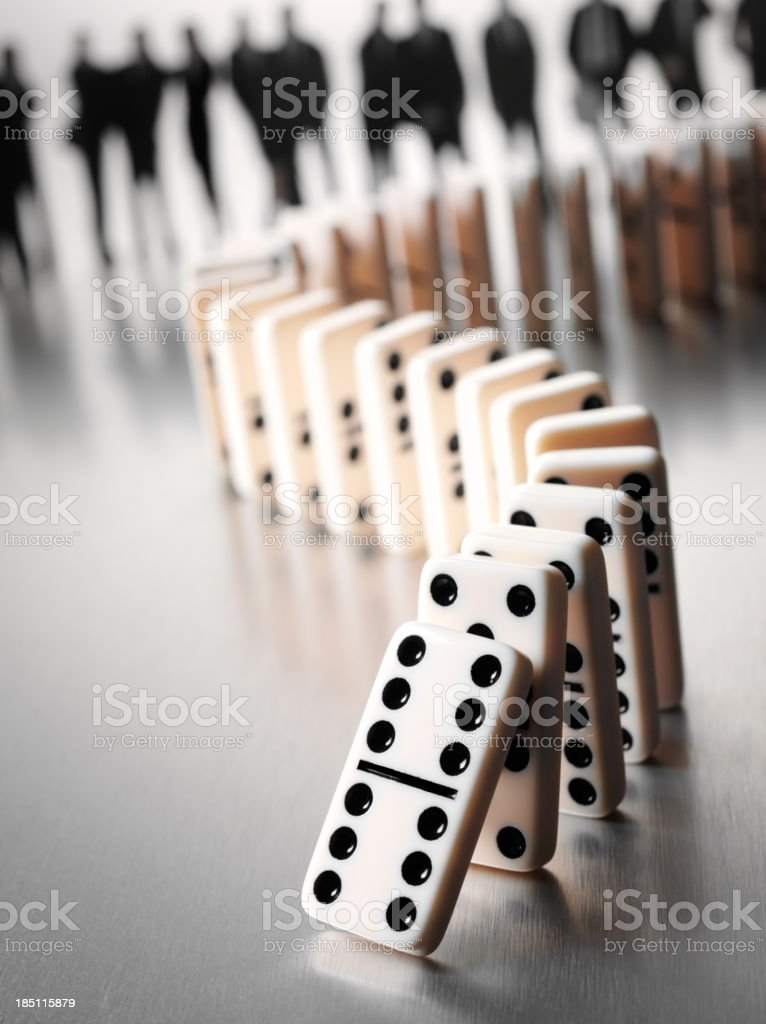 Domino Effect with Dominoes and a Business Team stock photo