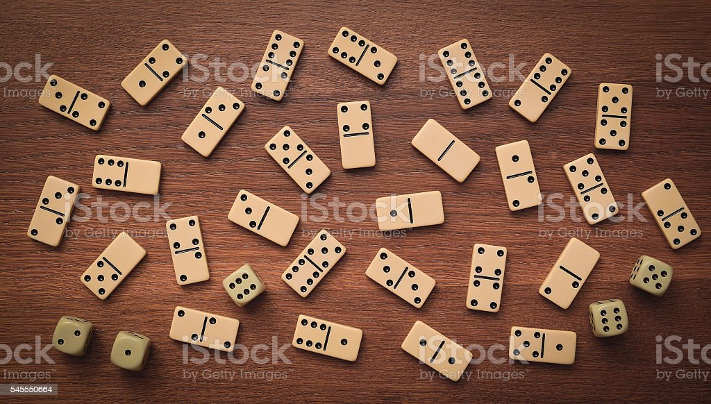 dominoes and dice background stock photo