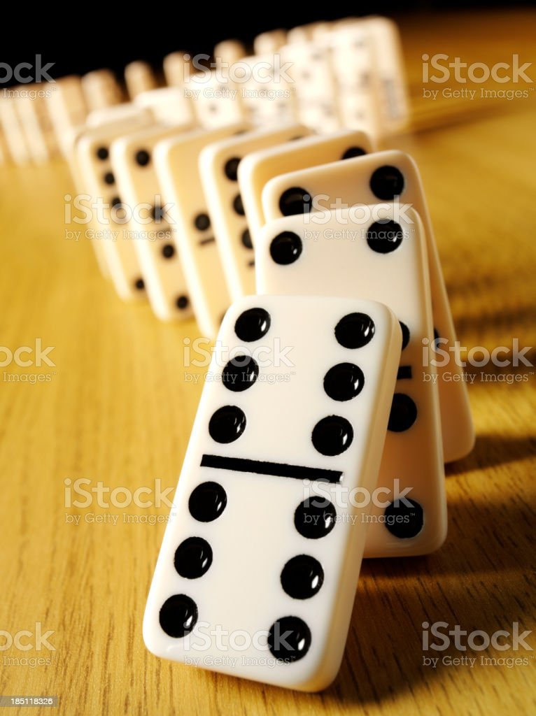 Dominoes Falling in the Domino Effect stock photo
