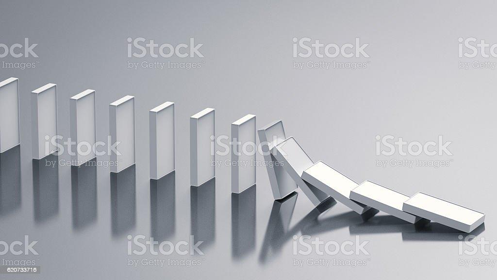 dominoes falling stock photo