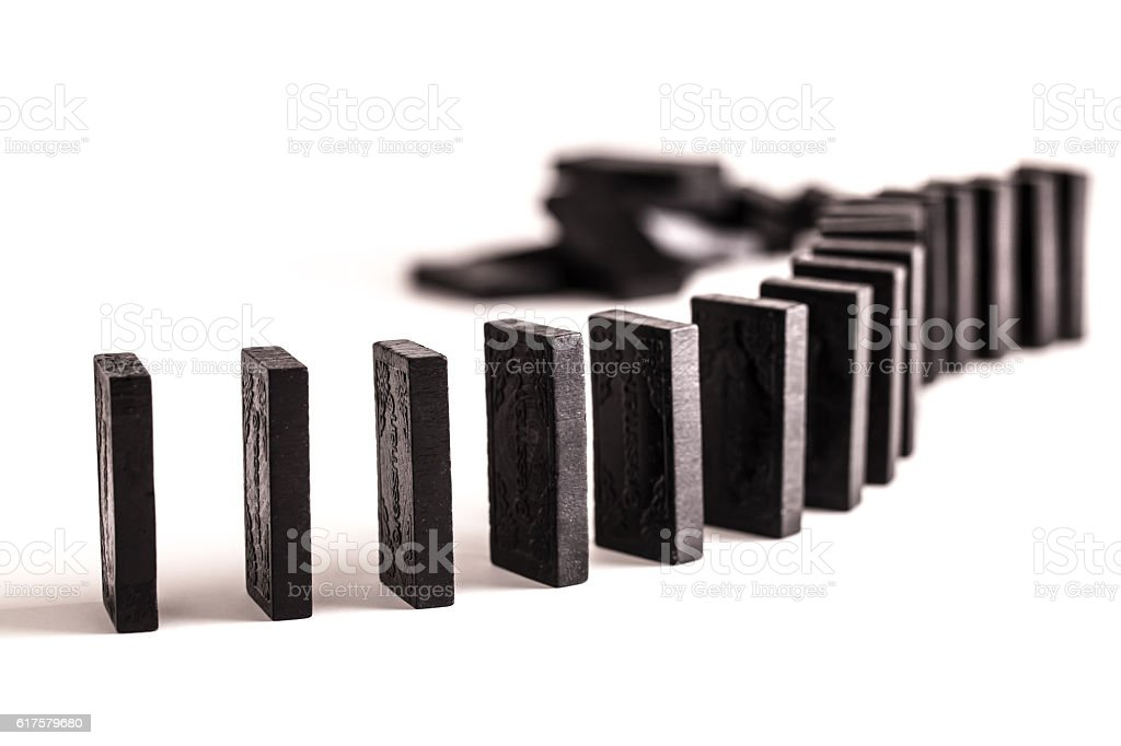 Dominoes in a line stock photo