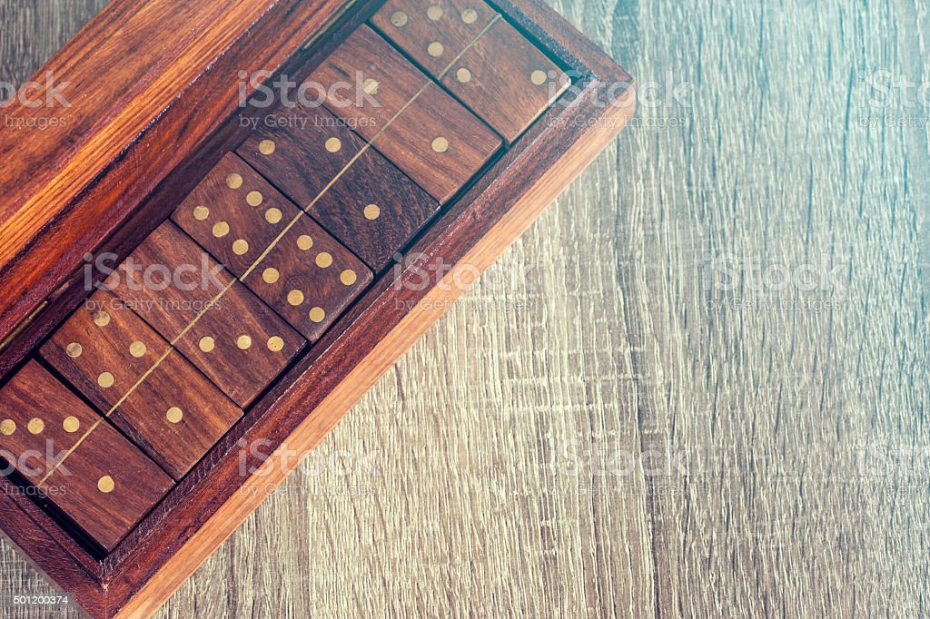 Dominoes on a wooden box stock photo