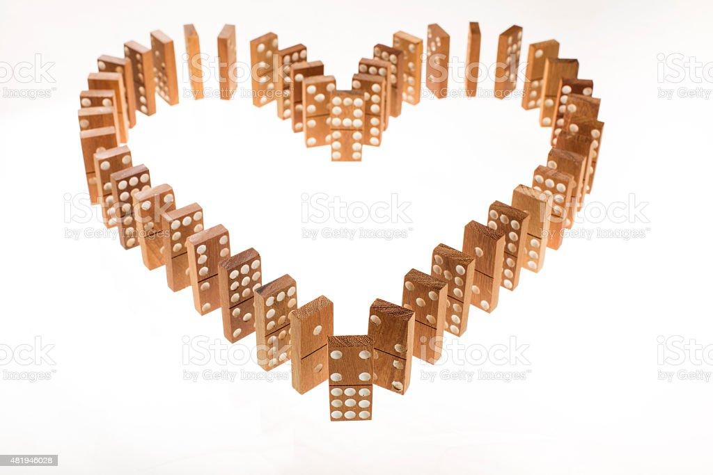 Dominoes standing in heart shape stock photo