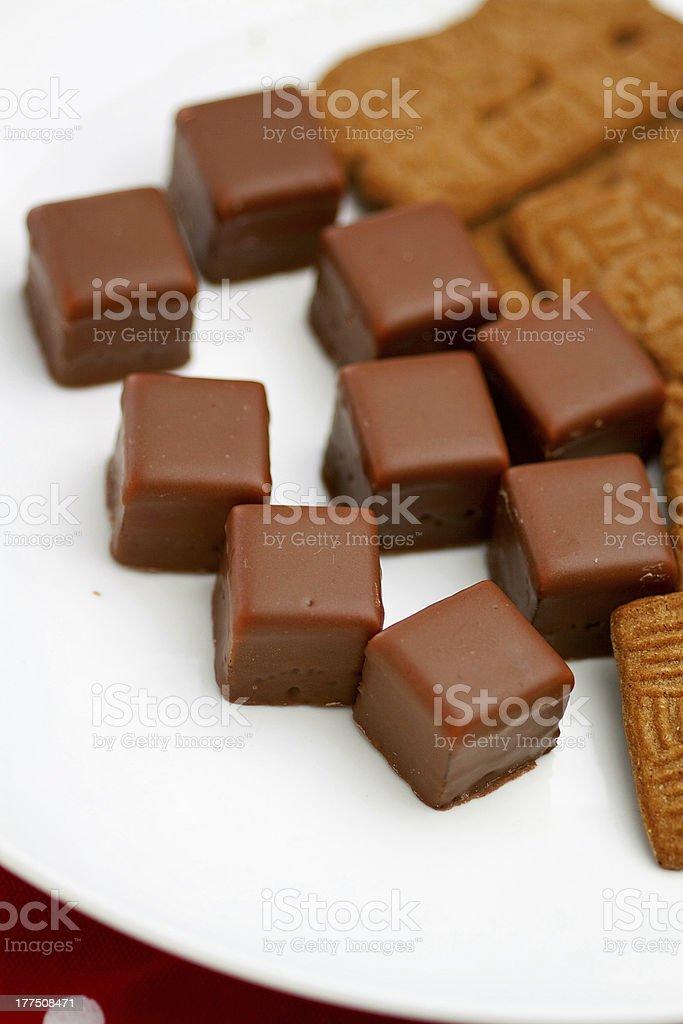 Dominosteine on white plate and spekulatius (german christmas cookies) stock photo