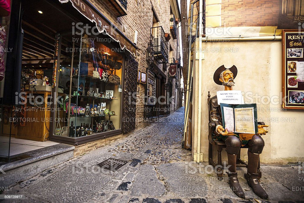 Don Quixote holding restaurant menu on Toledo street, Spain stock photo