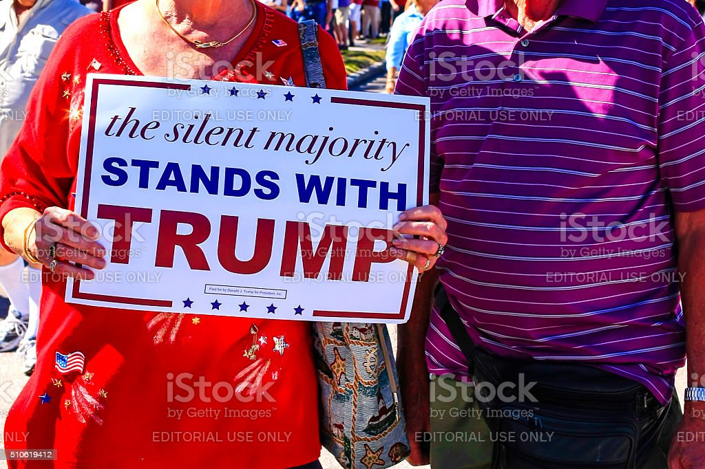 Donald Trump supporter holding pro-trump poster stock photo